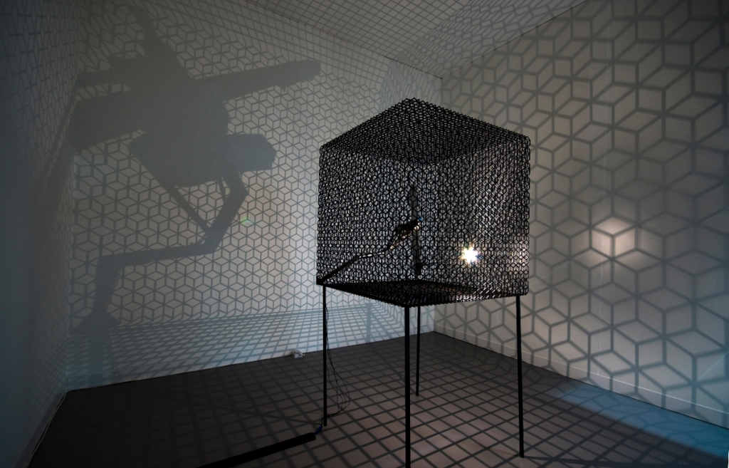 Conrad Shawcross, 'Slow Arc Inside a Cube IV', 2009. Steel mesh, mechanical system, light. 120 x 120 x 180 cm. Courtesy the artist and Victoria Miro, London